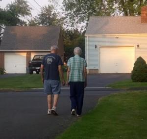 Henry Kolodziej walking with wife Peg to build strength.