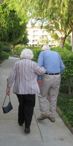 Caregiver of the Month Bob Roney walking with his wife